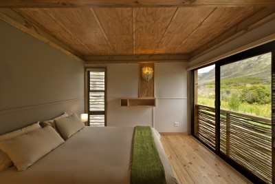 Cabin bedroom with unobstructed views of the landscape