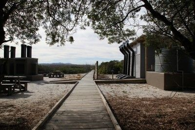Boardwalks lead to communal facilities such as composting toilets and braai areas